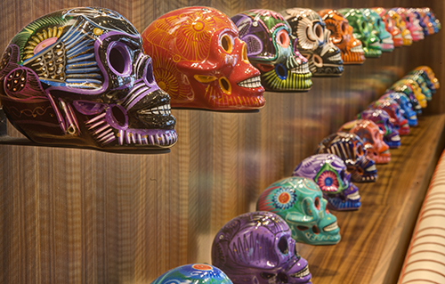 Sugar skulls hand painted in Mexico adorn the walls at Torre